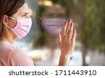 young woman in virus mask... | Shutterstock . vector #1711443910