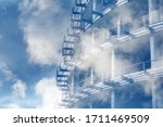 Small photo of Tinted background of concrete-metal structures for design on an architectural, construction theme. Fragment of an unfinished multi-story residential building or commercial property in the clouds