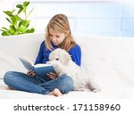 girl reading a book  | Shutterstock . vector #171158960