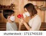 A Masked Son Gives Flowers To A ...