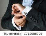 Businessman Adjusts His White...
