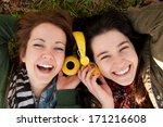 two happy teenage girls lying... | Shutterstock . vector #171216608