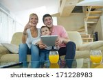 happy young family using tablet ... | Shutterstock . vector #171228983