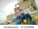 happy young family using tablet ... | Shutterstock . vector #171228986
