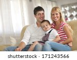 happy young family using tablet ... | Shutterstock . vector #171243566