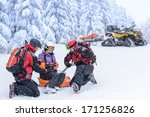 Ski Patrol Team Rescue Woman...