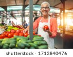 Woman Tending An Organic...