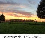 Sunset Over Green Grassy Field...