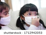 sister helping her younger... | Shutterstock . vector #1712942053