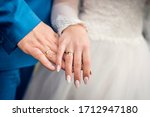 Husband And Wife Hands With...