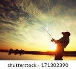 Man Fishing From A Boat At...