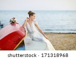beautiful bride sitting on a...   Shutterstock . vector #171318968