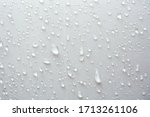 Water Droplets On White Textil...