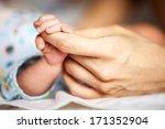 Newborn Baby Holding Mother's...