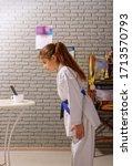 a little girl in a white kimono ...   Shutterstock . vector #1713570793