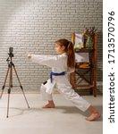 a little girl in a white kimono ... | Shutterstock . vector #1713570796