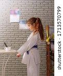 a little girl in a white kimono ... | Shutterstock . vector #1713570799
