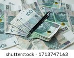 polish zloty on the table | Shutterstock . vector #1713747163