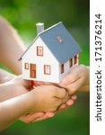 ecology house in hands against... | Shutterstock . vector #171376214