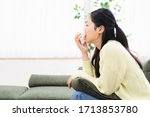 Woman Blowing Nose Shot In...