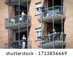 Small photo of Neighbors in Balconies during Coronavirus Lockdown. Turin, Italy - April 2020
