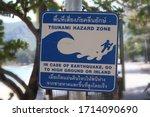 Tsunami Hazard Zone Sign Next...