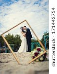 wedding couple in the frame.... | Shutterstock . vector #171442754