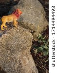 Toy Figurine Of A Lion On A Rock
