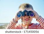 Boy Looks Through Binoculars...