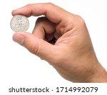 A Hand Holding A Quarter Dollar ...