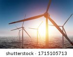 Windmills In The Sea At Sunset...