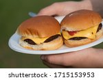 Hamburger Sandwich Between Perfectly Laid Buns With Cheese And Ketsup.