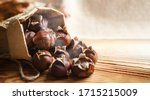 Chestnuts on a wooden...