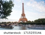 Small photo of Paris, France - September 29, 2017: Seine river cruises and Eiffel tower. Boat rides. Waterside trips. Sightseeing tour. Landscape and landmarks travel. Traveling and wanderlust. Summer vacation.