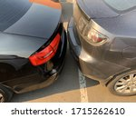 Two cars next to each other. Cars are parked very close. Small clearance from bumper to bumper. Kiev, supermarket parking, April 13, 2020. - stock photo