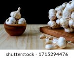Garlic Bulbs In Wooden Bowl And ...
