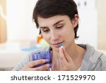 woman taking medication | Shutterstock . vector #171529970