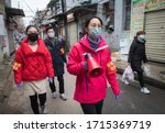 Small photo of Community workers use a speaker to publicize the information about prevention and control of the novel coronavirus at a street in Wuhan, central China's Hubei Province, Feb. 7, 2020.