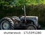 A Vintage Tractor Parked...