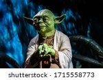 Small photo of London, England, UK - January 2, 2020: Waxwork statues of Master Yoda from Star Wars, Madame Tussauds waxwork museum, one of the popular touristic attractions