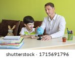 boy with father doing homework... | Shutterstock . vector #1715691796
