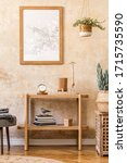 Small photo of Stylish scandinavian interior of living room with mock up poster frame, wooden console, plants, grey stool, decoration, grunge wall and elegant personal accessories in modern home decor.