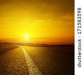 Asphalt Road And Orange Sunset