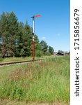 Small photo of Old semaphore on the narrow gauge railway. Analog semaphore on the railway.