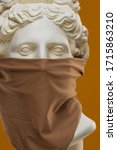 A protective scarf on the face of the statue of Apollo - stock photo