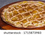 Small photo of Sweet pizza with banana, sweet sigh and cinnamon. Traditional Brazilian sweet pizza with banana and sigh.