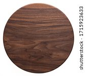 Small photo of Handmade black walnut round wood plate. Walnut round wooden tray. Black walnut wood plank texture background.