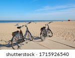 Bicycles Parked On A Sandy...