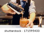 Stock photo bartender is making cocktail at bar counter 171595433