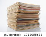 Small photo of Files Stacking up in a Messy Order. Document, Paper, File, White Background.